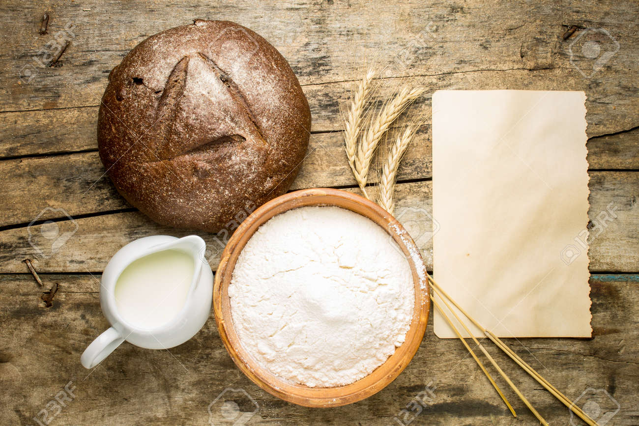 bakery recipe background loaf of rye bread with ingredients stock