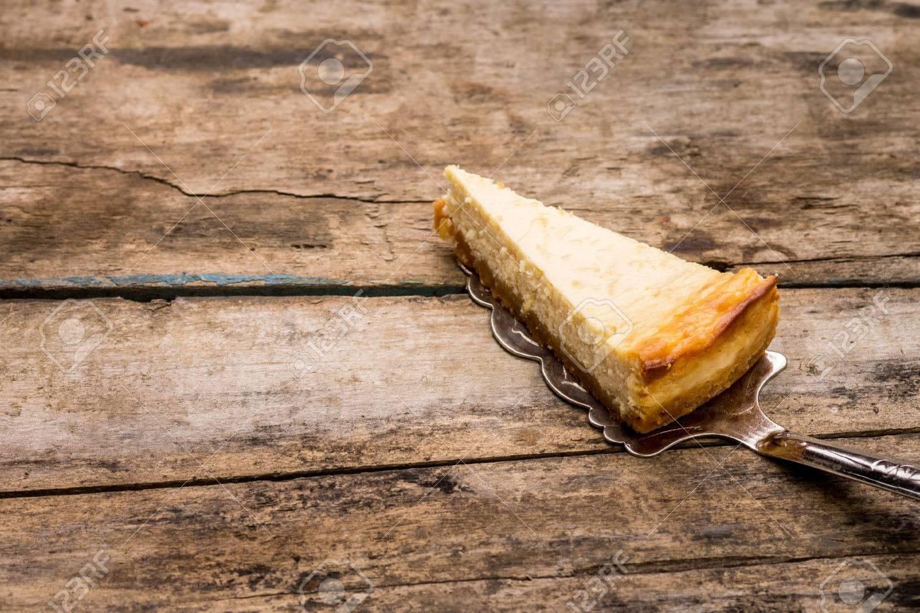 Cheesecake slice on wooden background. Recipe and menu dessert background - 38737664