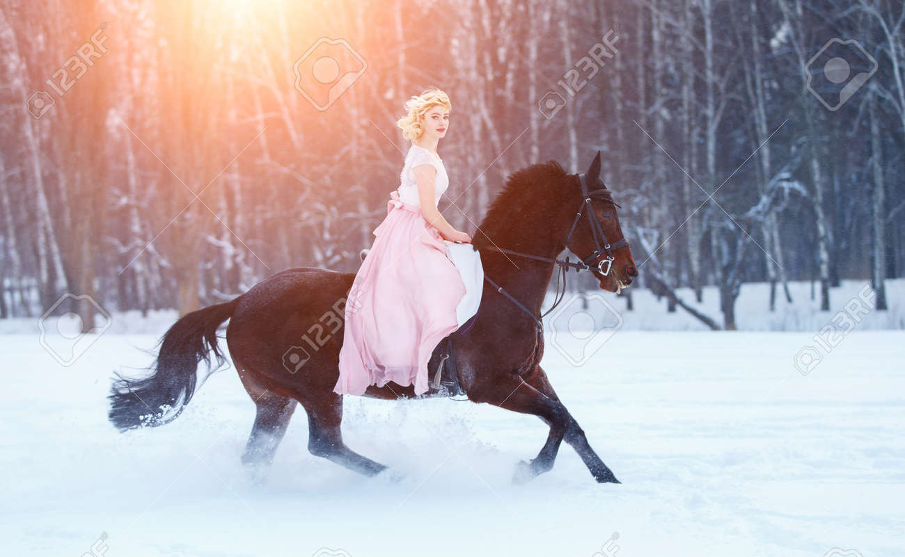 Young Woman In Dress Riding Horse On Winter Field Stock Photo Picture And Royalty Free Image Image 99193379