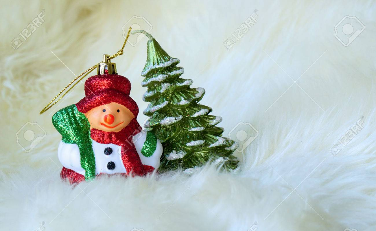 Small Snowman And Christmas Tree On White Fur Christmas Tree Stock Photo Picture And Royalty Free Image Image 70209076