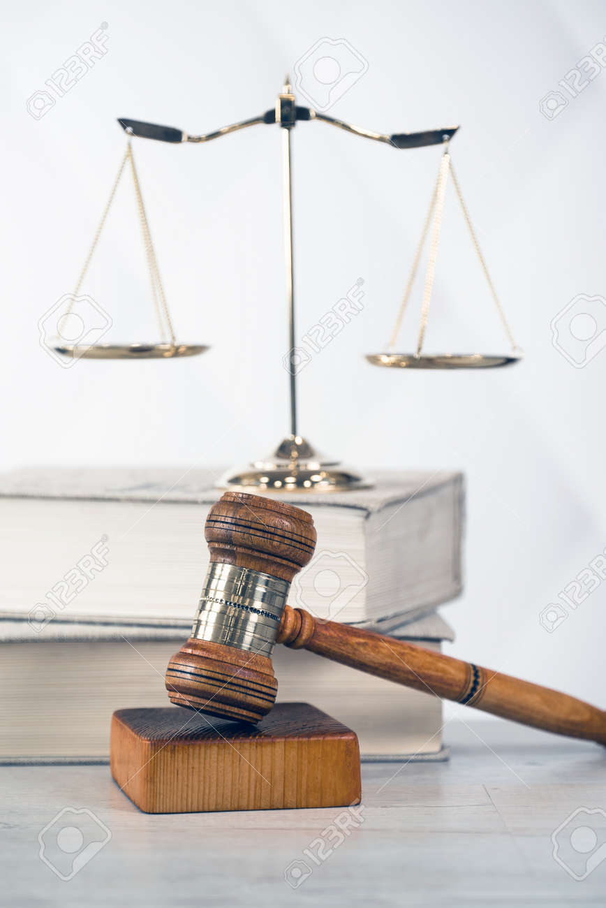 Law theme, mallet of the judge, wooden desk, books - 89213430