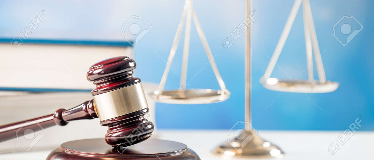 Law, justice and legal system concept with a wooden gavel judge symbol on blue background. - 92440890