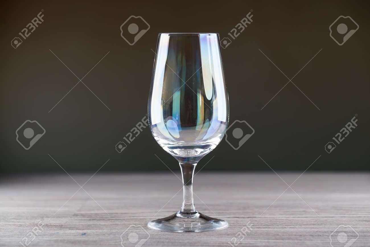 Wine glass on wooden table - 142549904