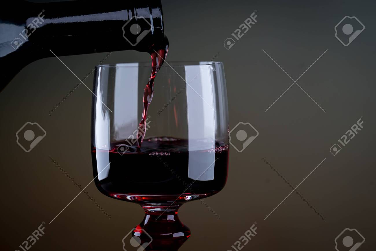 Bartender pours red wine - 142549902