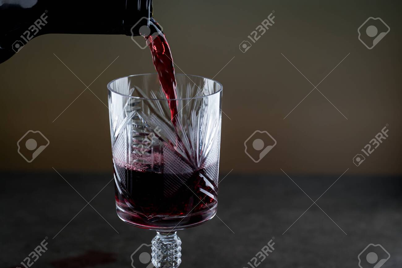 Bartender pours red wine - 142549905