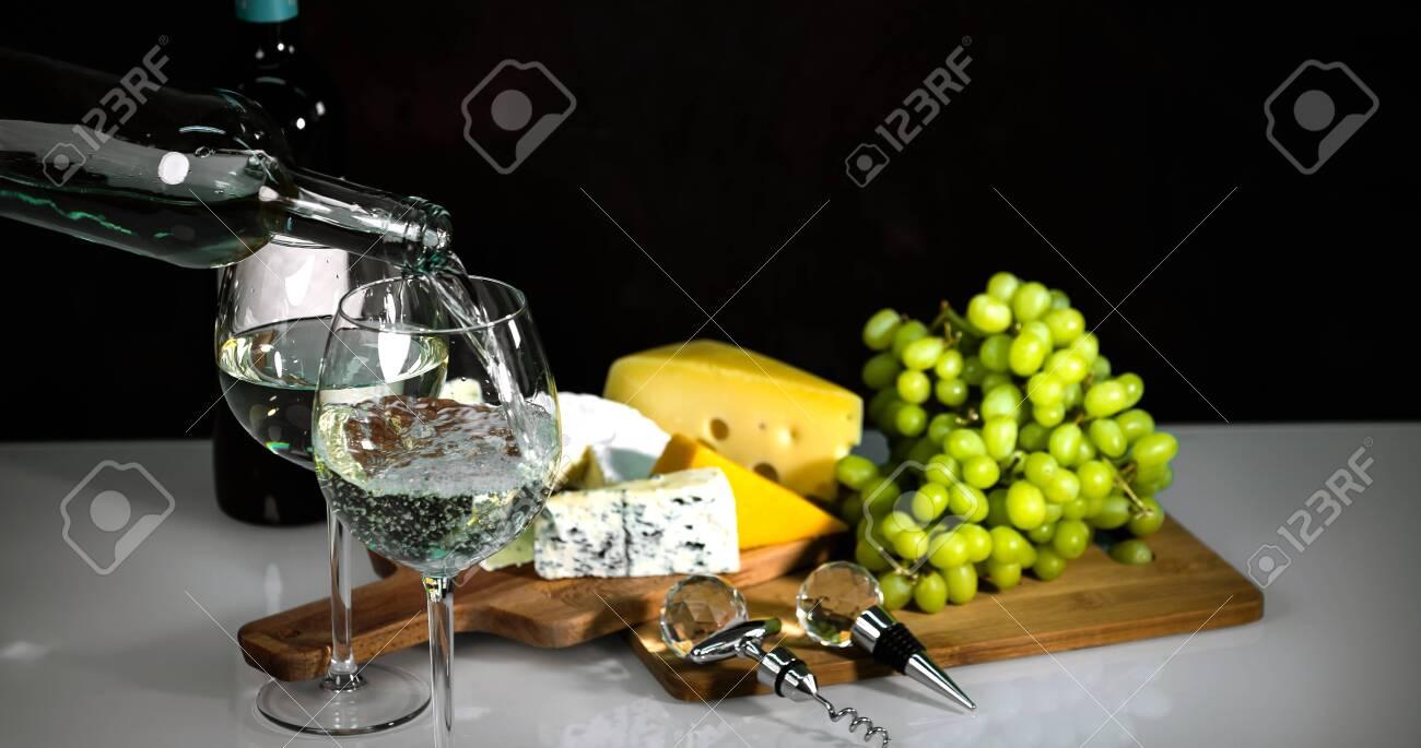 Bartender pours white wine - 142549906