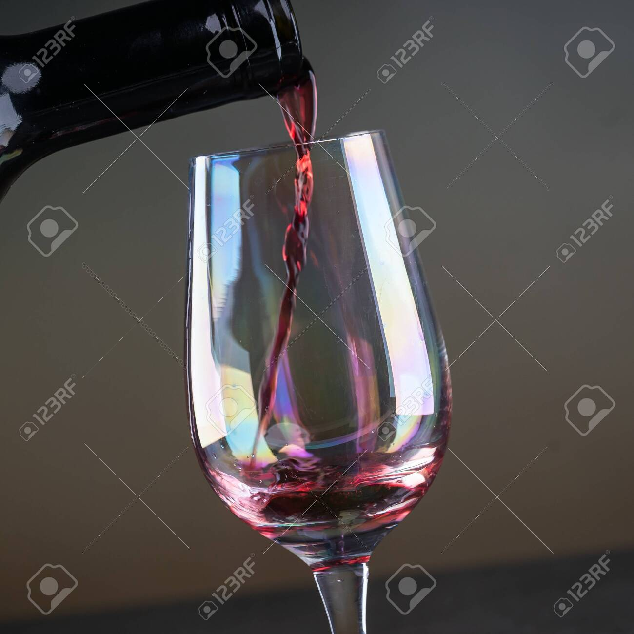 Red wine being poured into a glass close-up - 142549810