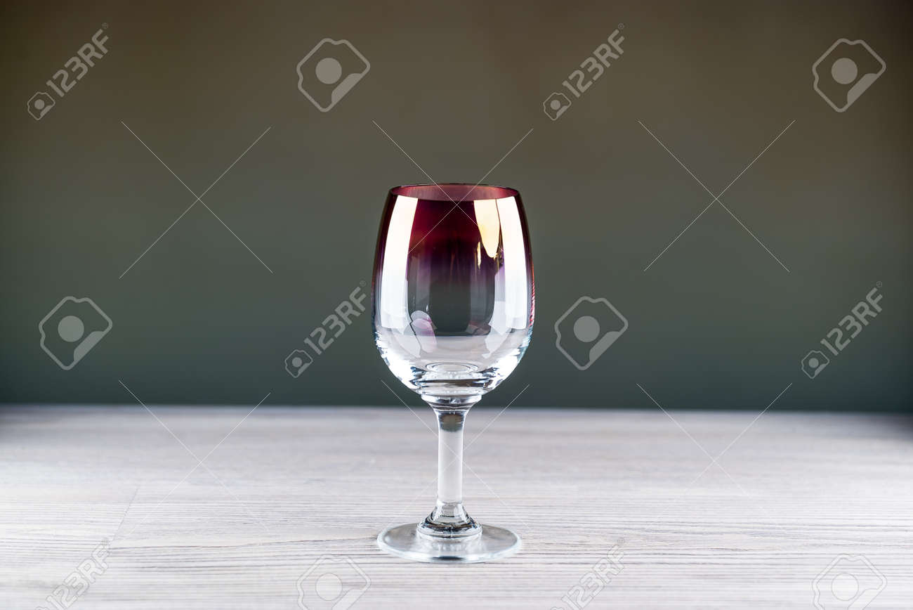Red wine being poured into a glass close-up - 142549814