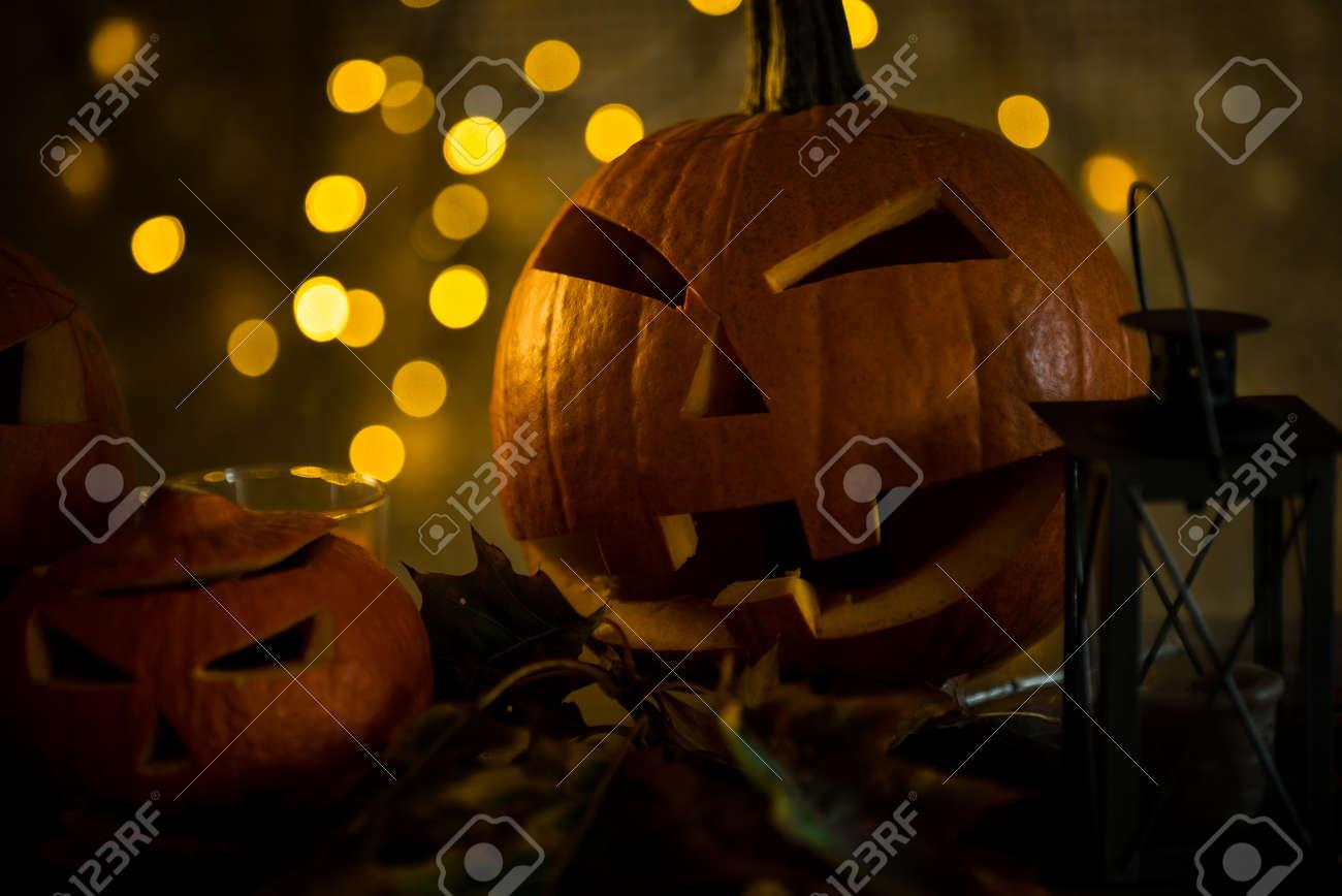 Halloween pumpkin head jack lantern with burning candles in scary deep night - 141470800