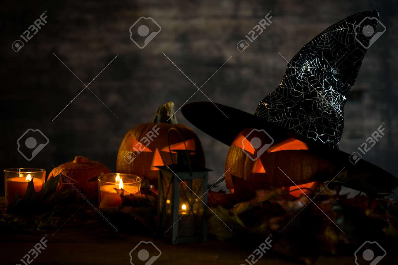 Halloween pumpkin head jack lantern with burning candles in scary deep night - 141470812