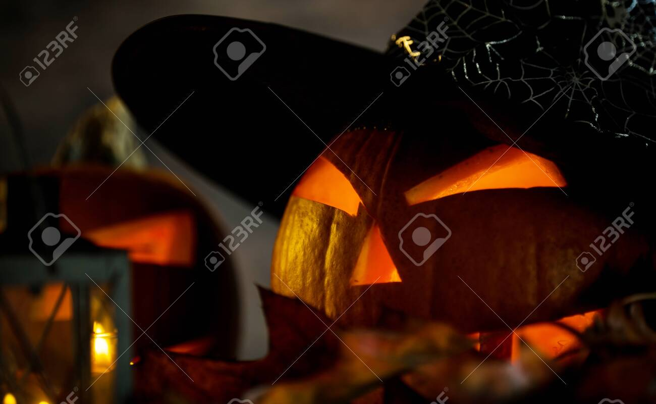 Halloween pumpkin head jack lantern with burning candles in scary deep night - 141470818