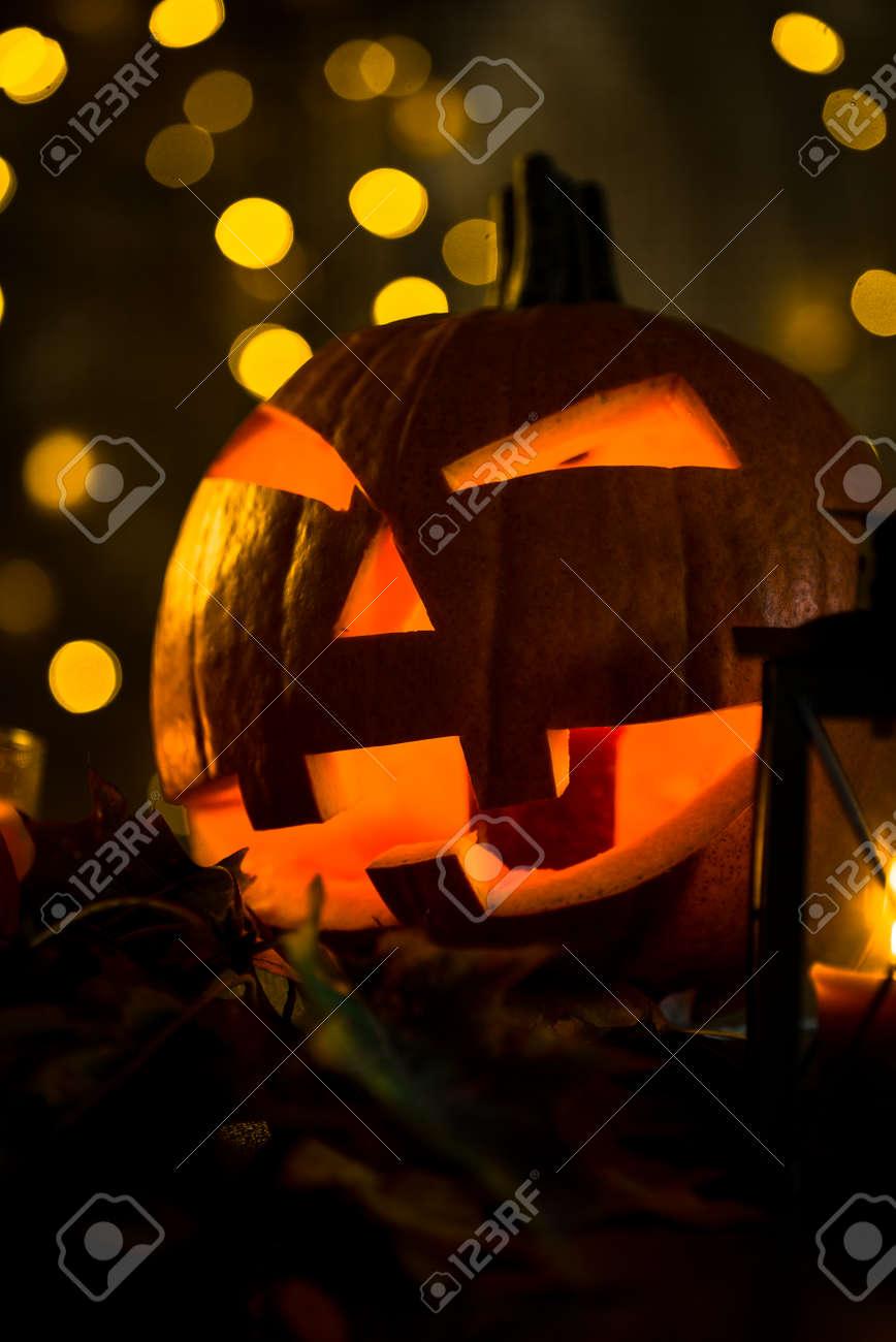 Halloween pumpkin head jack lantern with burning candles in scary deep night - 141470902