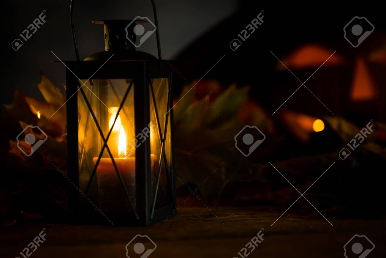 Halloween pumpkin head jack lantern with burning candles in scary deep night - 141470945