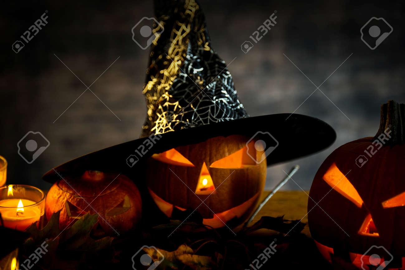 Halloween pumpkin head jack lantern with burning candles in scary deep night - 141470949
