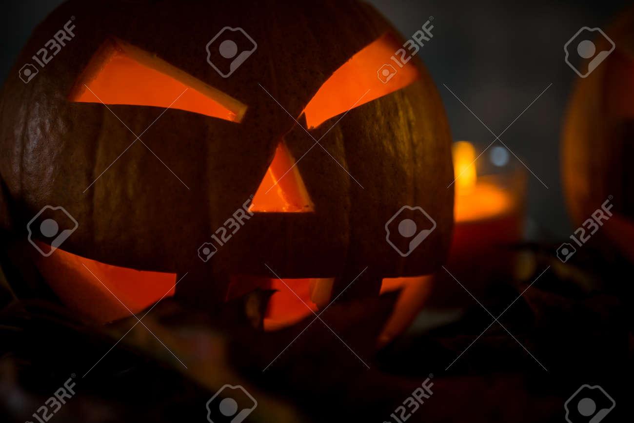 Halloween pumpkin head jack lantern with burning candles in scary deep night - 141470953