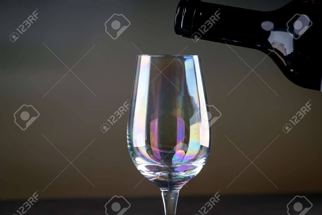 Red wine being poured into a glass close-up - 142548096