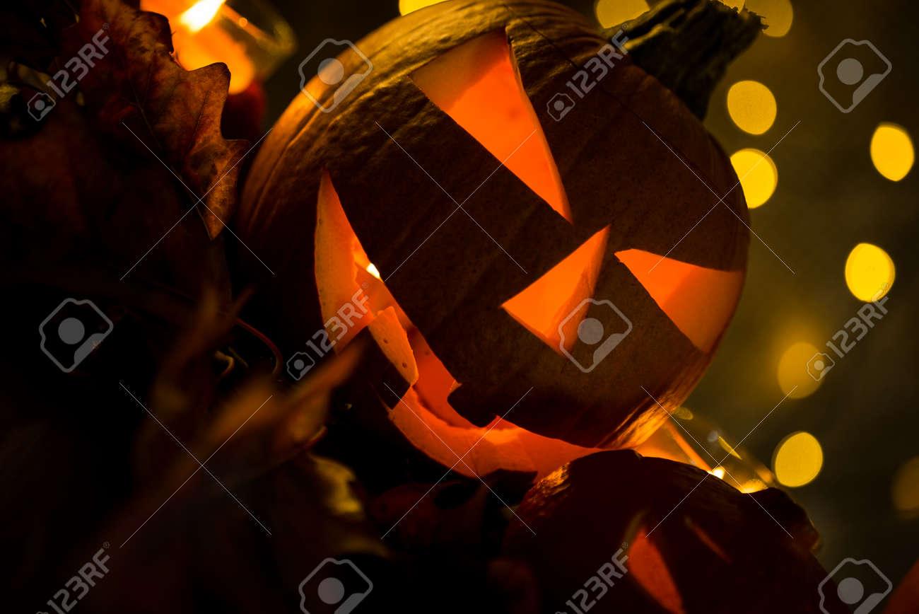 Halloween pumpkin head jack lantern with burning candles in scary deep night - 141471193