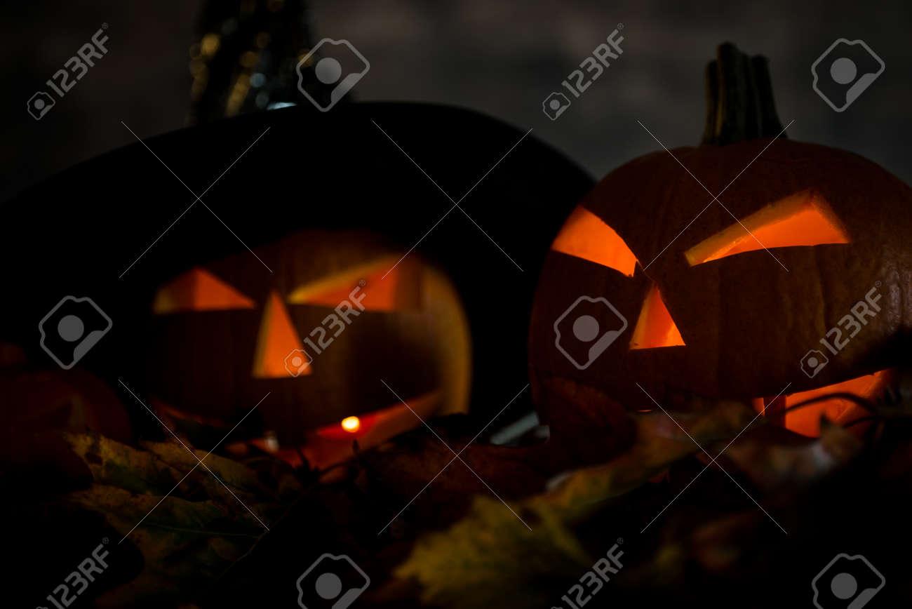 Halloween pumpkin head jack lantern with burning candles in scary deep night - 141471253