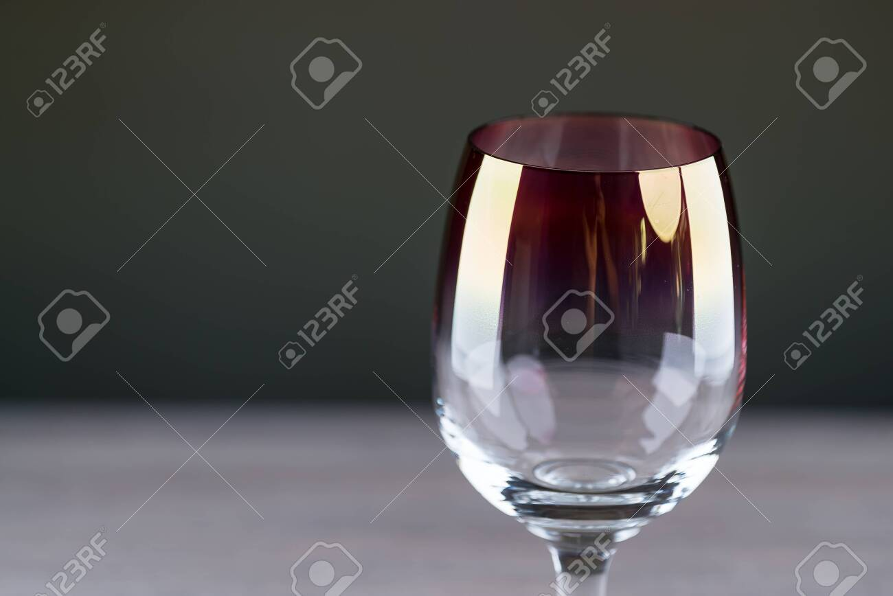 Pouring red wine from a bottle into a wineglass: wine tasting and celebration - 144316165