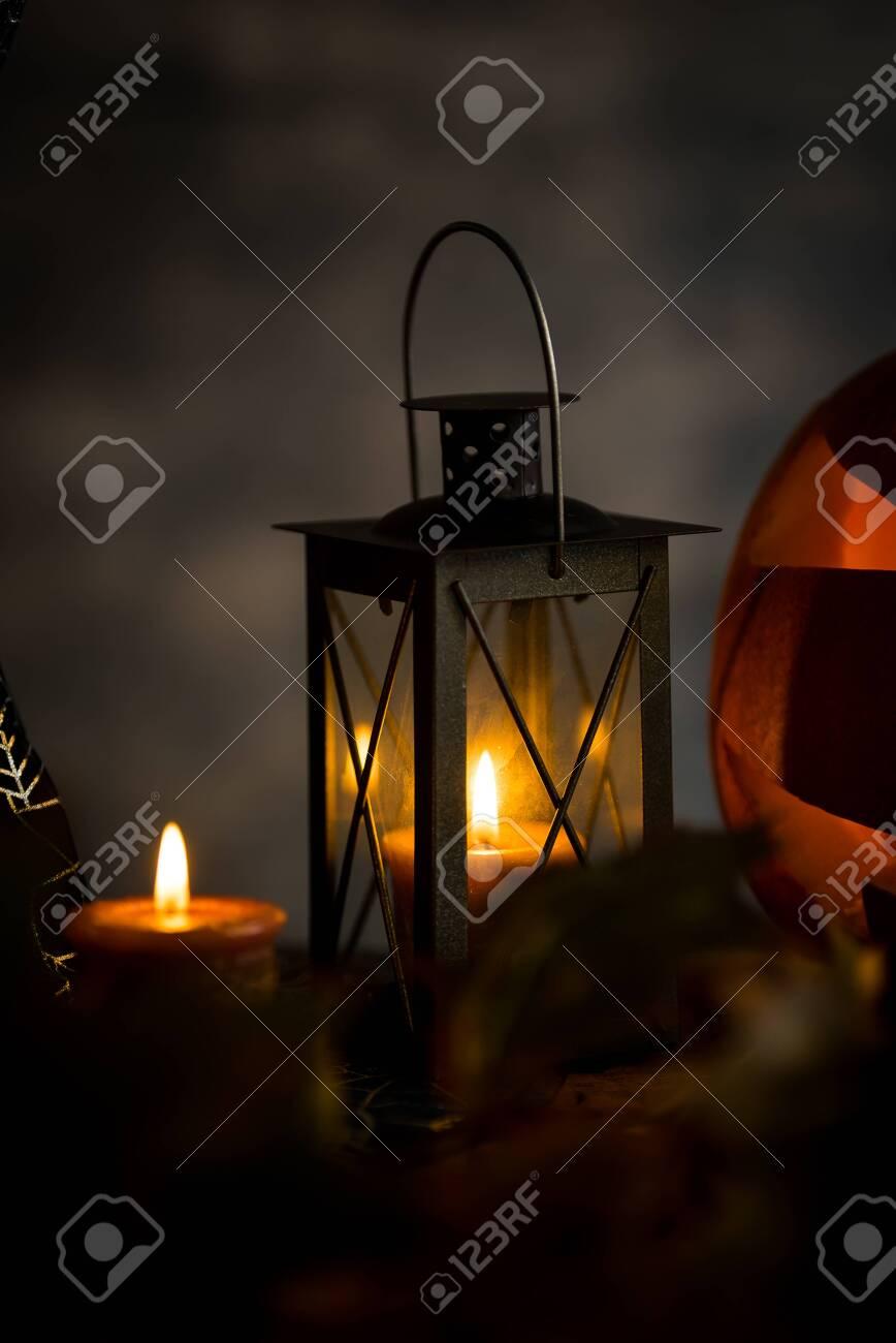Halloween pumpkin head jack lantern with burning candles in scary deep night - 141471270
