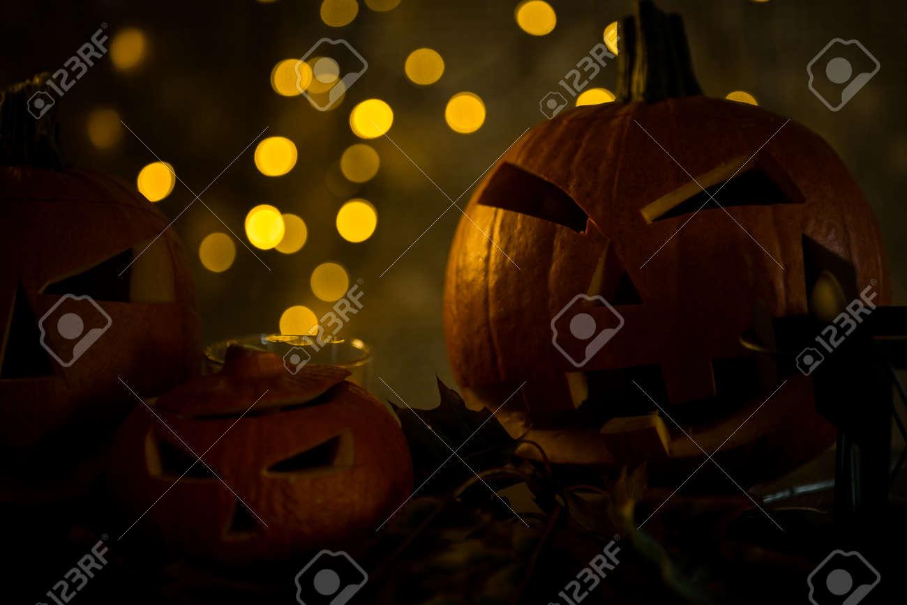Halloween pumpkin head jack lantern with burning candles in scary deep night - 142547861