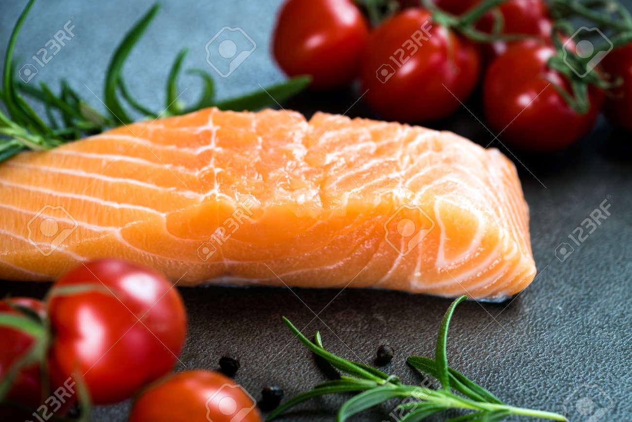 Fresh salmon on the cutting board. - 98678782