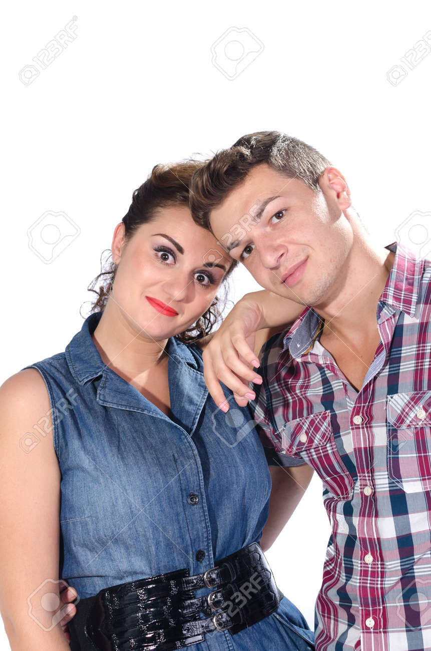 Portrait of young couple smiling against white background Stock Photo - 16654061