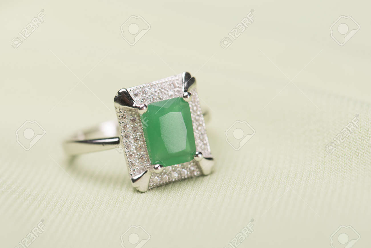 Green Stone Ring Against A Light Green Background Stock Photo   42945028