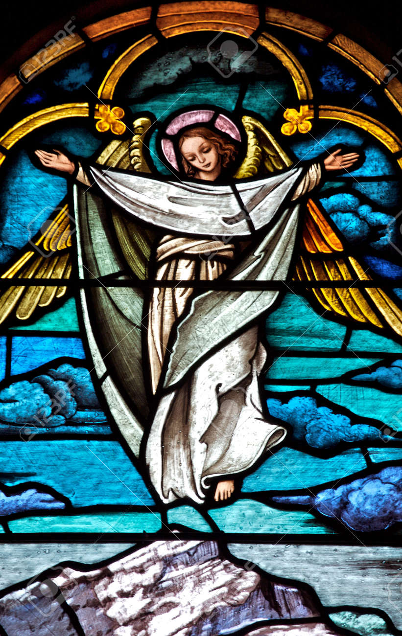 Stained glass church window depicting an angel Stock Photo - 11651994
