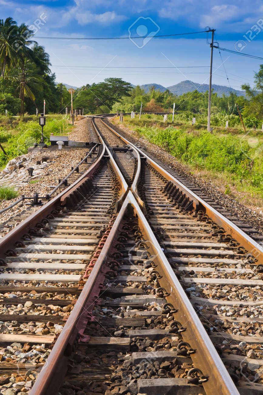 curve railway track with mountain background stock photo picture