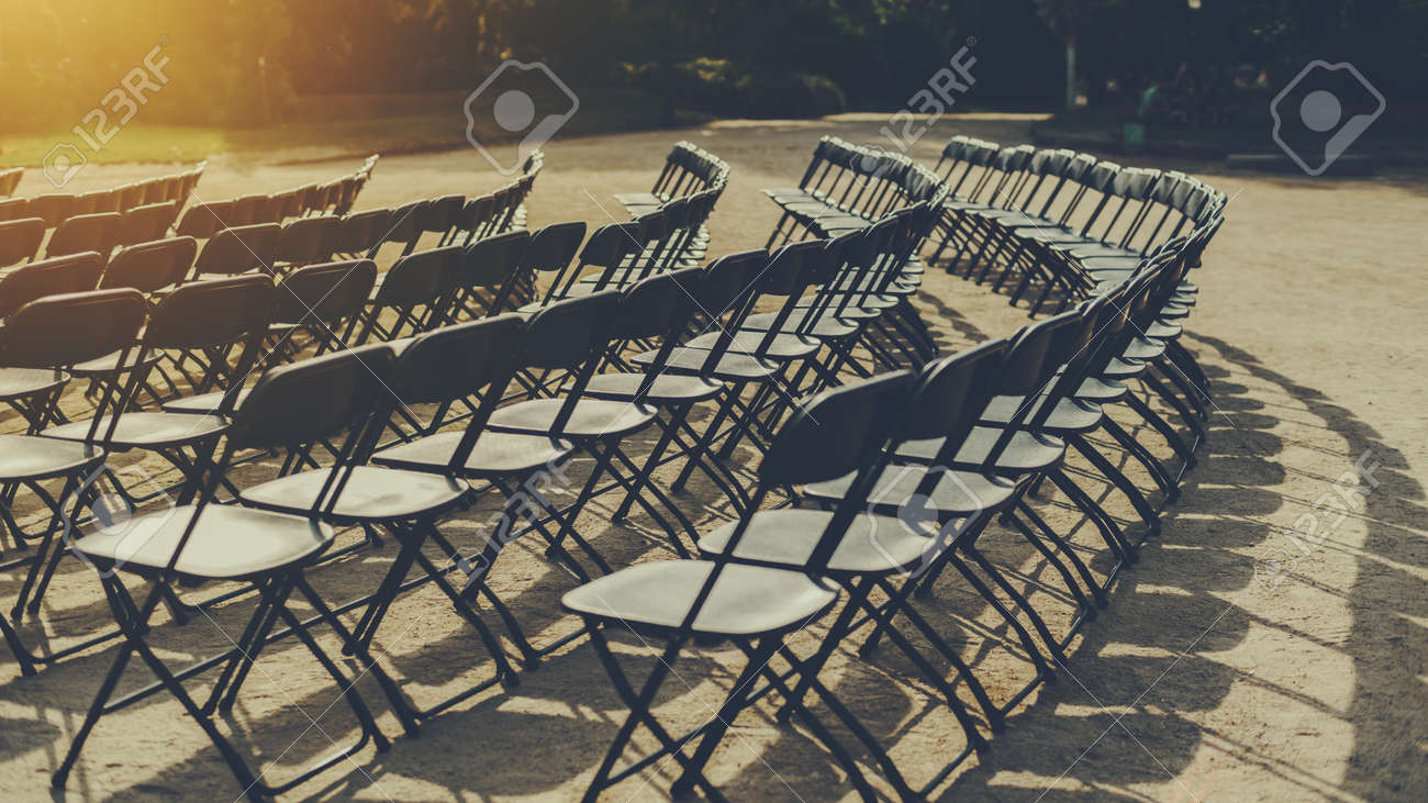 Gentil Empty Seat Rows Of Folding Chairs On Ground Before A Concert, Parallel And  Rounded Arranged