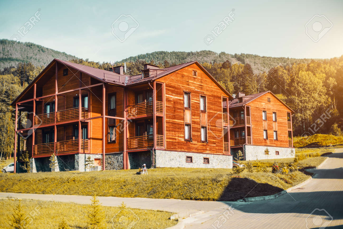 Modern simple and neat wooden duplex-type houses on autumn sunny