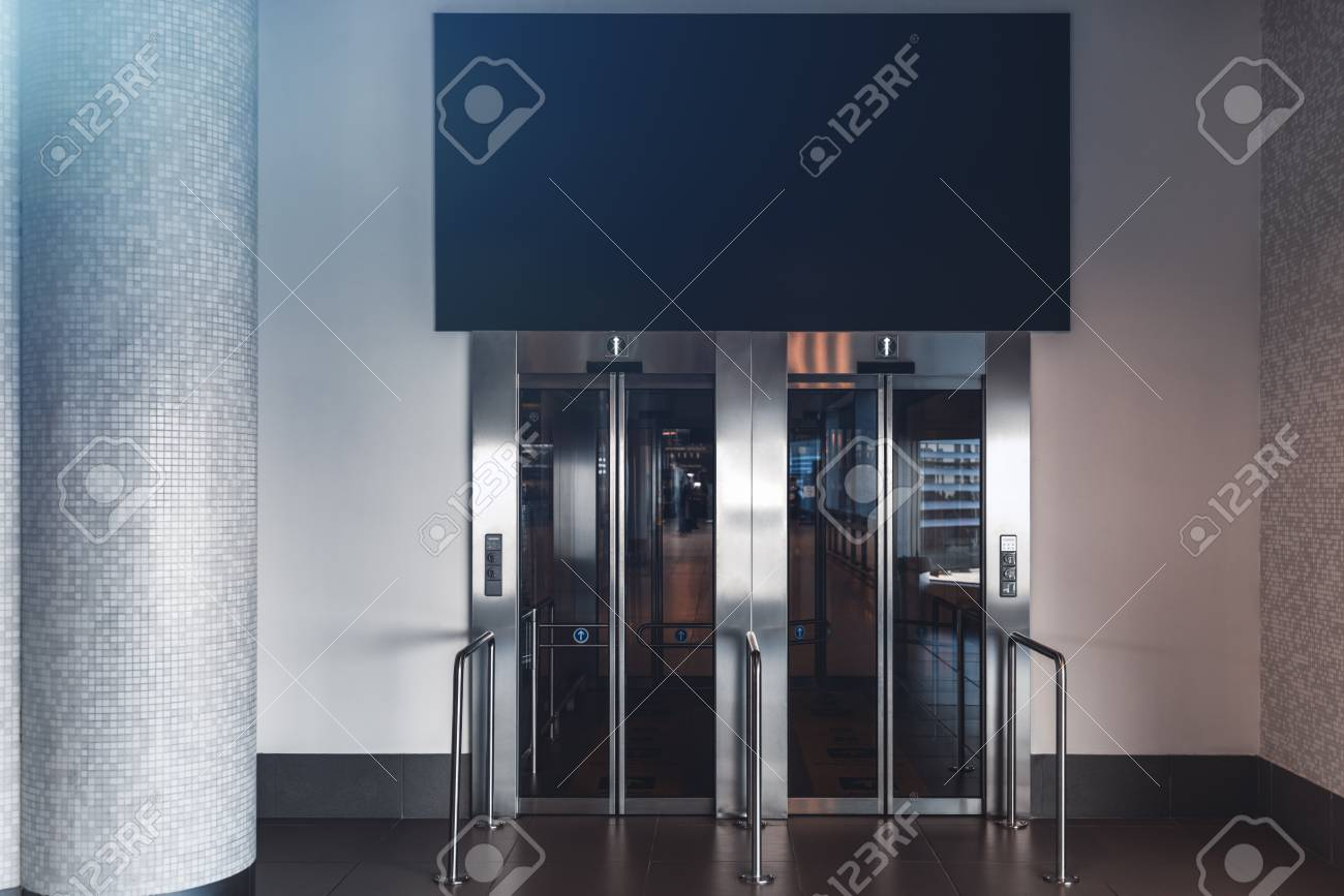 Clean And Neat Double Elevator In A Modern Airport Terminal Or A Railway  Depot Station With