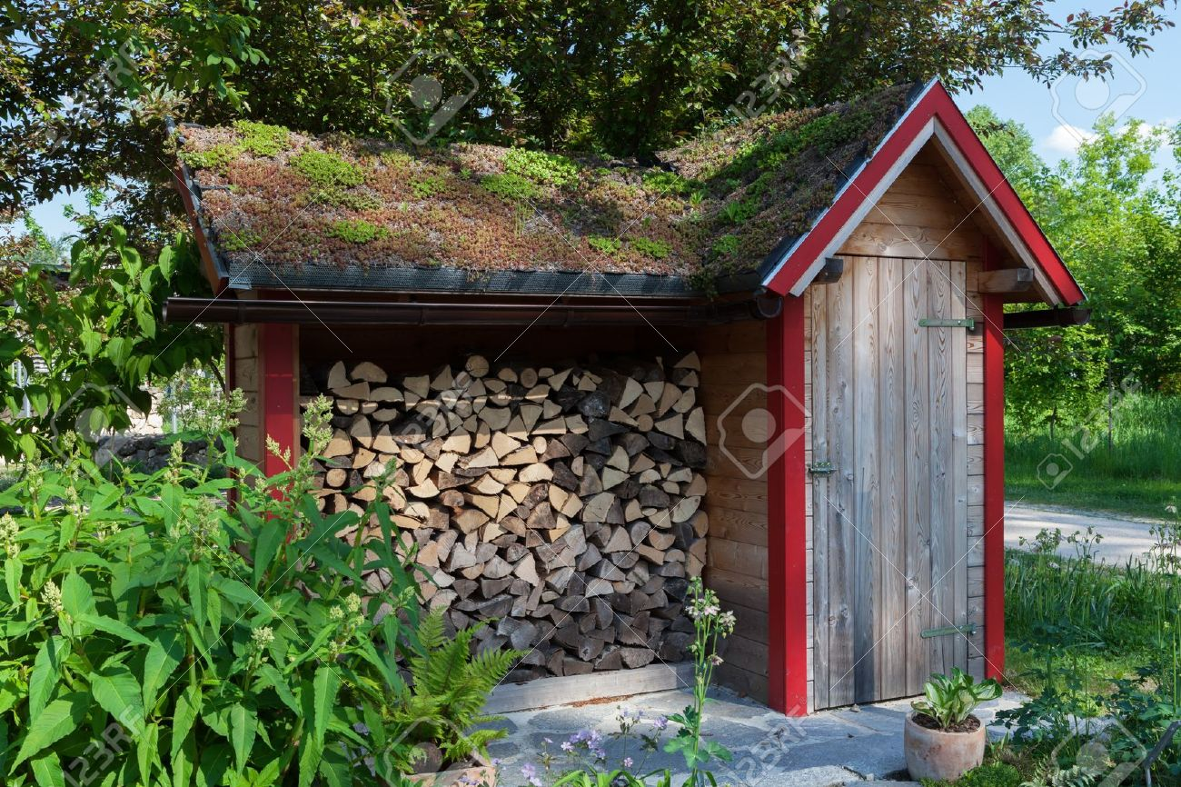 High Quality Small Hut In The Garden With Firewood Stock Photo   15334208