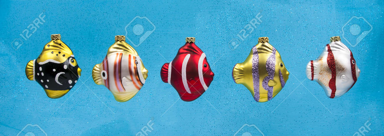 Glass Fish Christmas Ornaments Isolated On Blue Background With ...