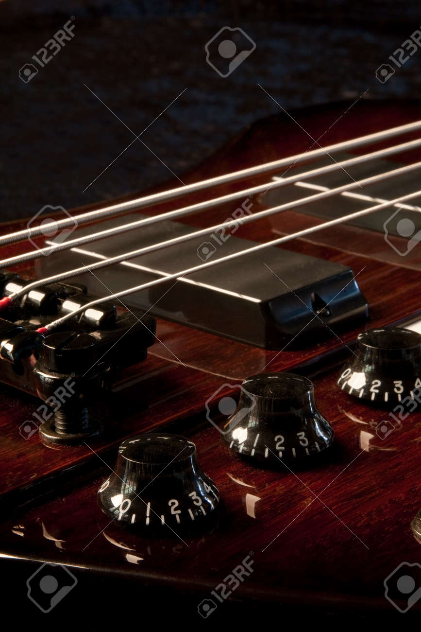 A base guitar shot in the studio against a black background Stock Photo - 6634936