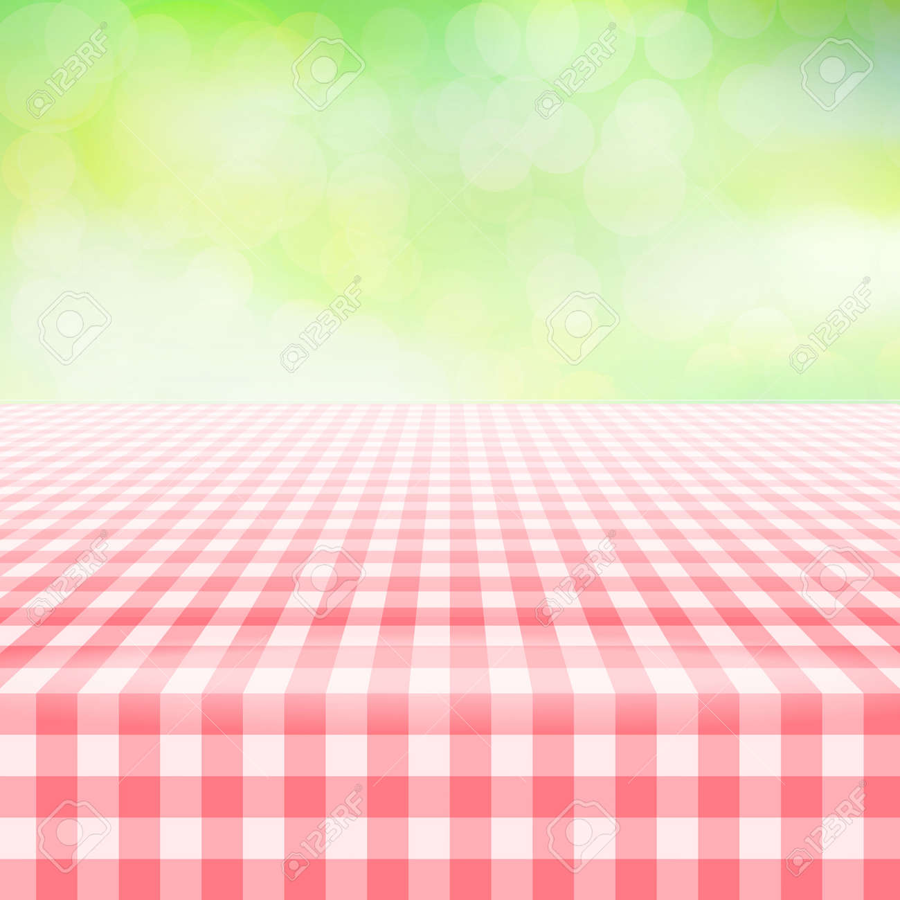 empty picnic table covered with checkered gingham tablecloth