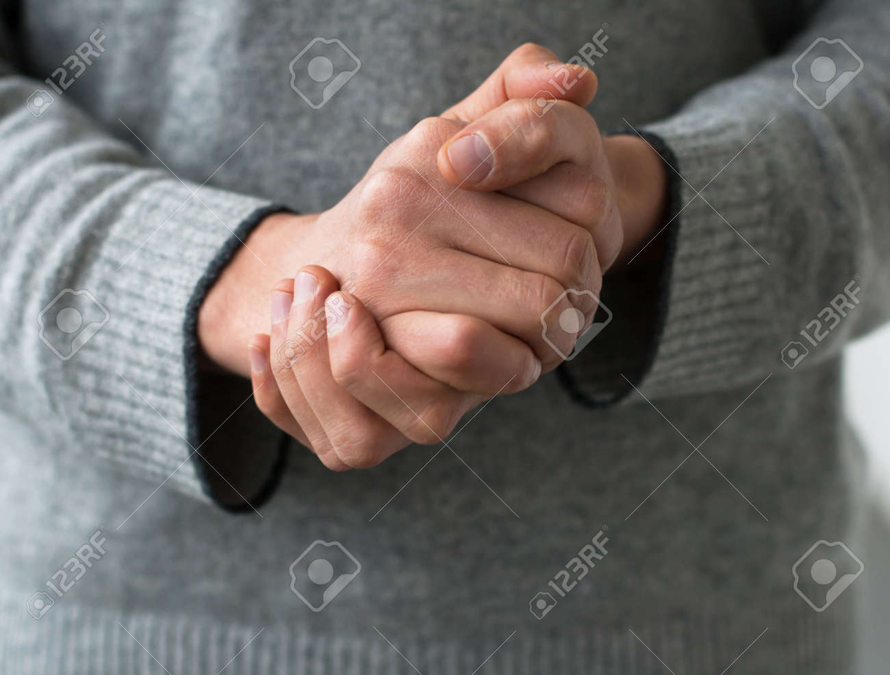 A man holds his hands folded Stock Photo - 18298543
