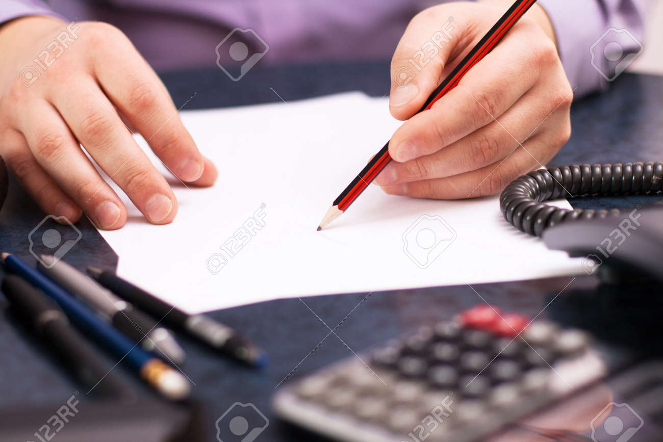 Businessman sitting at office desk and plans its work Stock Photo - 18298488