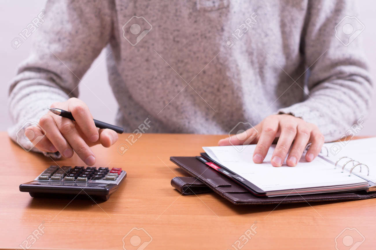 Businessman sitting at office desk and plans its work Stock Photo - 18298521