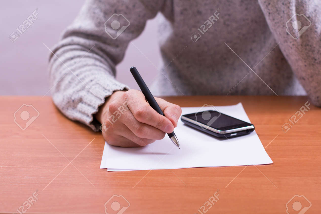 Businessman sitting at office desk and plans its work Stock Photo - 18298469