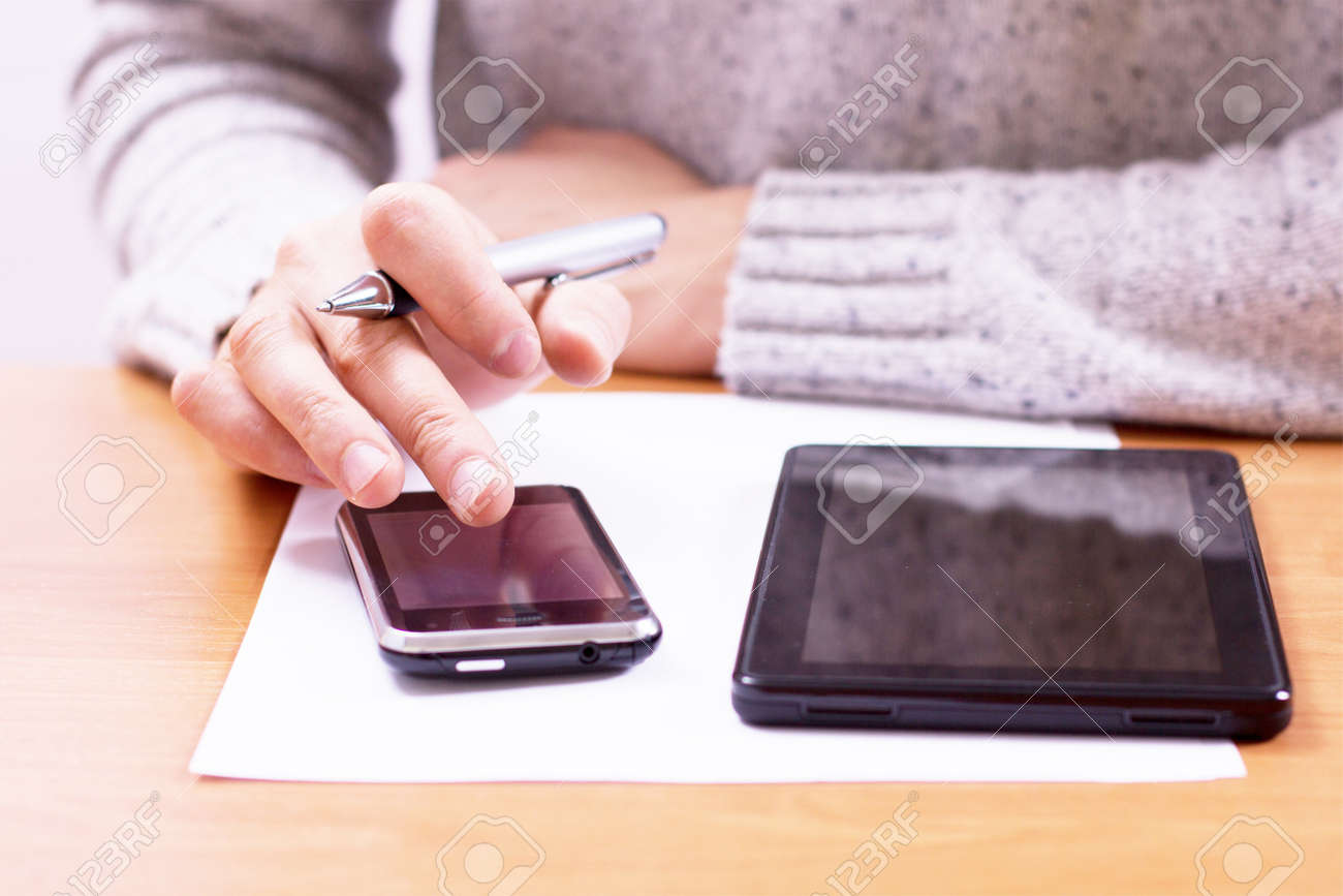 Businessman sitting at office desk and plans its work Stock Photo - 18298449