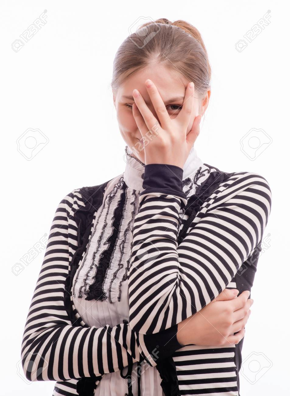 Woman Peaking Through Hands on her face Stock Photo - 18529317
