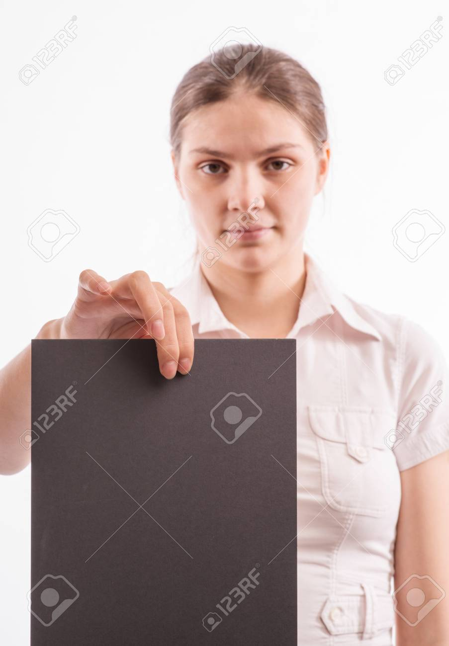 Young beautiful girl holding a sheet of colored paper Stock Photo - 18524865