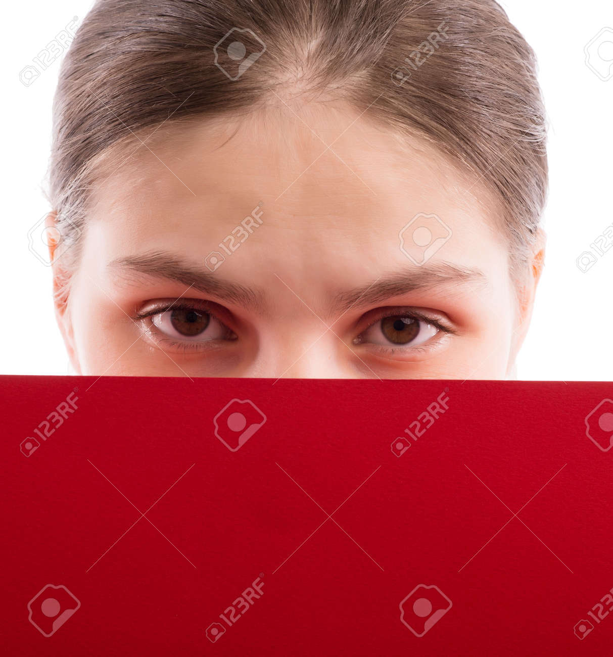 Young beautiful girl holding a sheet of colored paper Stock Photo - 18529349