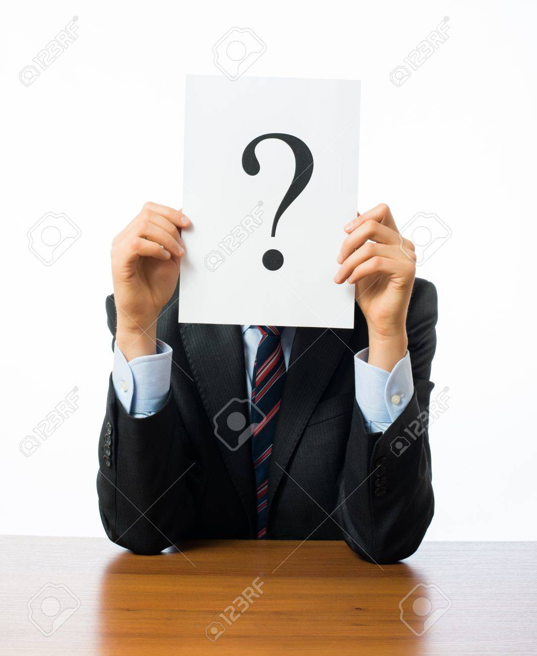 Businessman keeps a question mark Stock Photo - 18923213