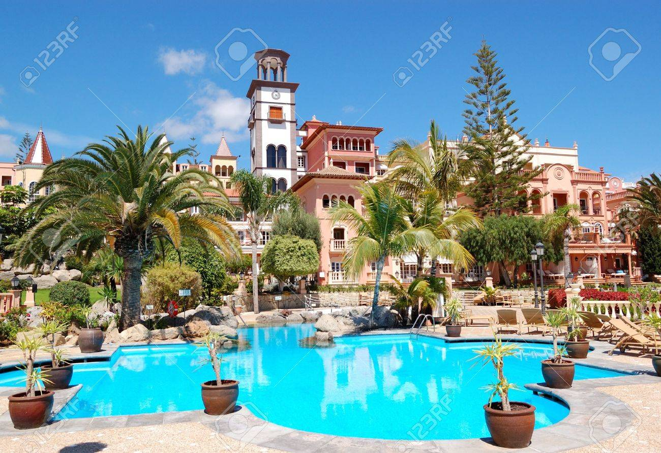 Tower With Clock And Swimming Pool At The Luxury Hotel Tenerife