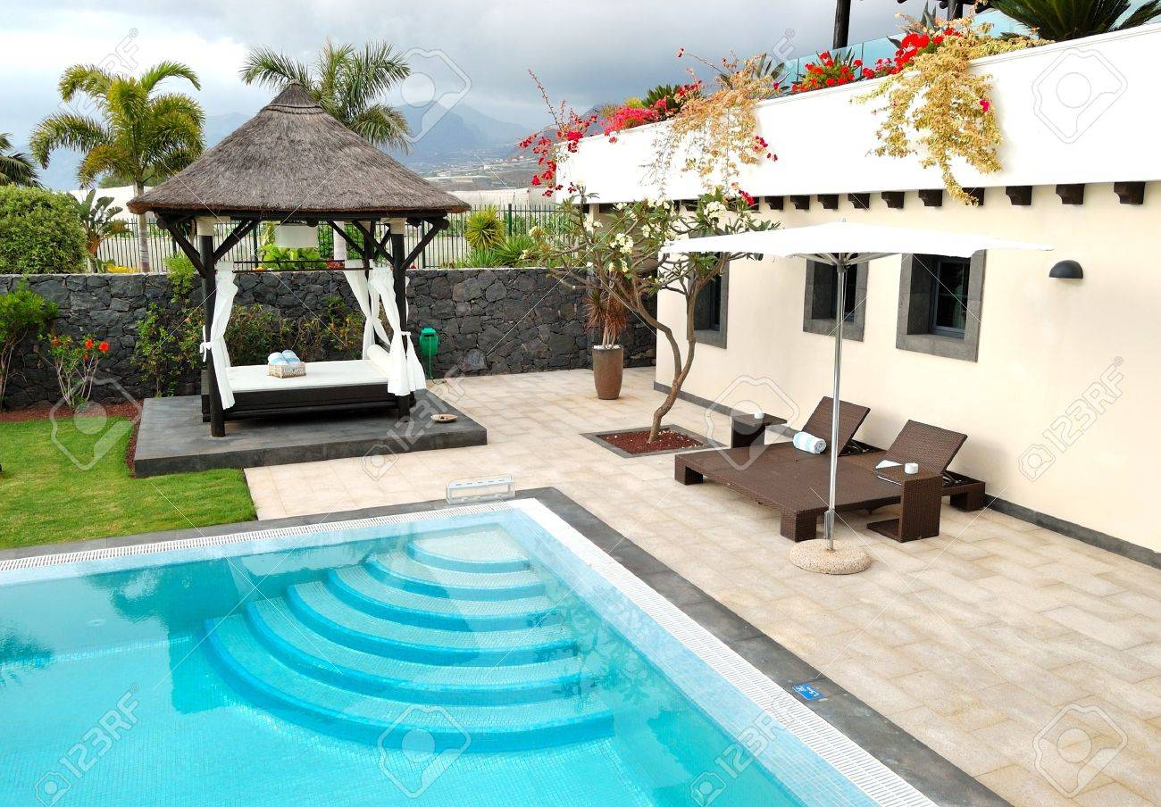 hut and swimming pool at luxury villa tenerife island spain stock photo