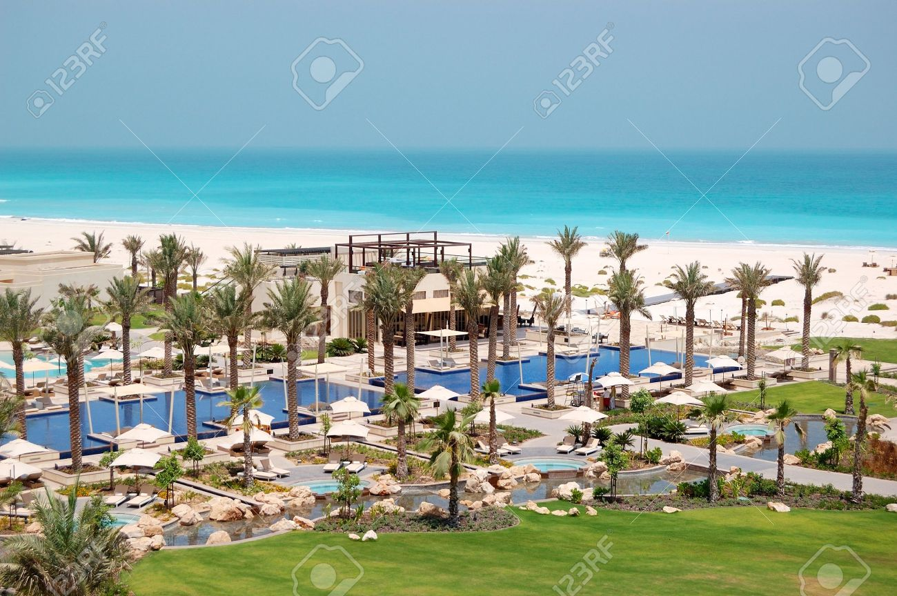 Swimming pools and beach at the luxury hotel saadiyat island abu dhabi uae