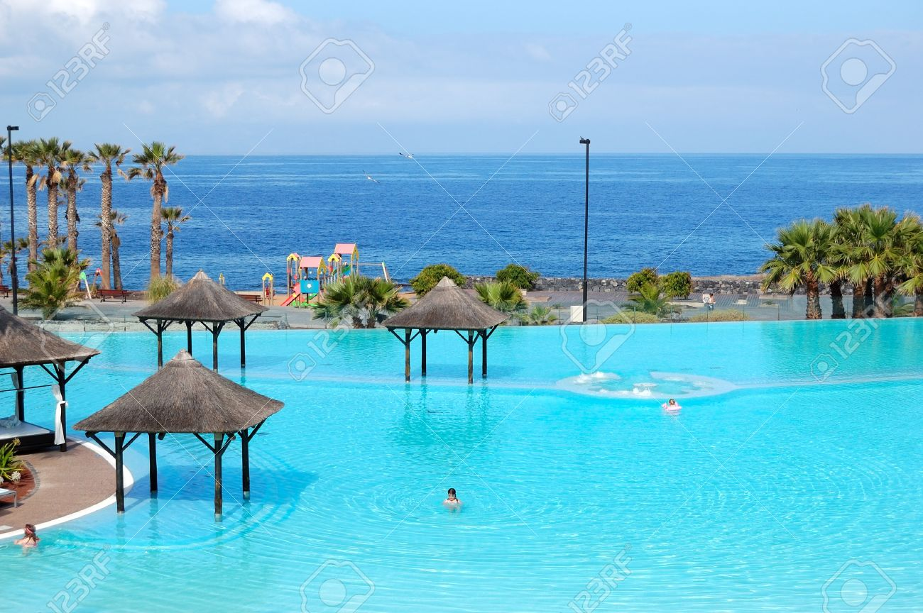 Swimming Pool With Jacuzzi And Beach Of Luxury Hotel Tenerife